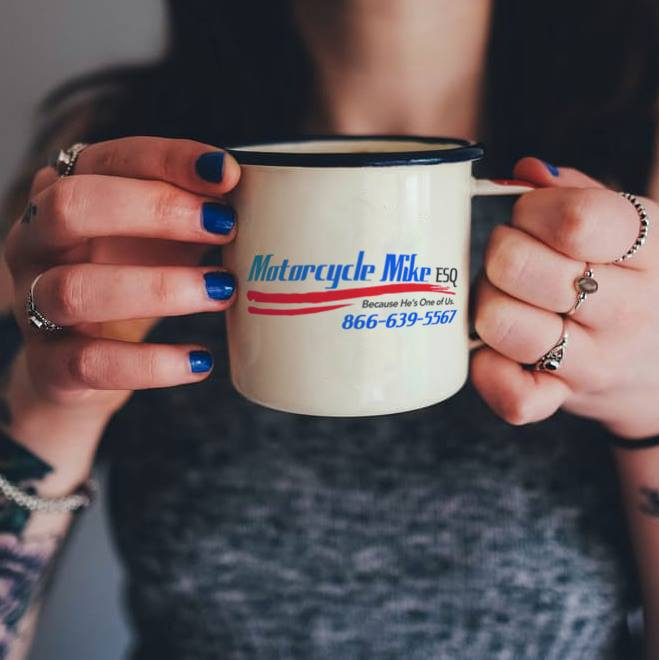 person with holding a cup of coffee with both hands